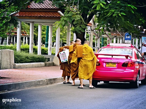 Monk in taxi